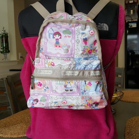 222ca6daf06 Lesportsac Handbags - Lesportsac a Small World Well Wishes Mini Backpack